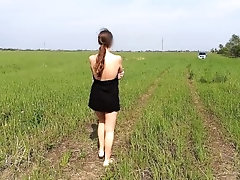 nude walk on the field nearby to...